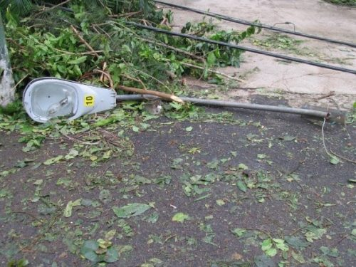 A lamppost fallen, amidst debris